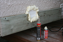 Sealing a vent opening with expanding foam insulation
