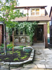 Our house - porch, trellis, stone walk, garden all done by yours truly